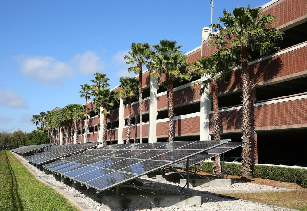 Long line of solar panels converting the sun's rays into electricity
