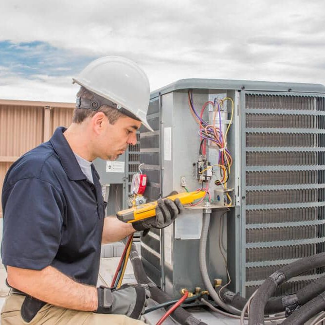 Trained hvac technician holding a voltage meter