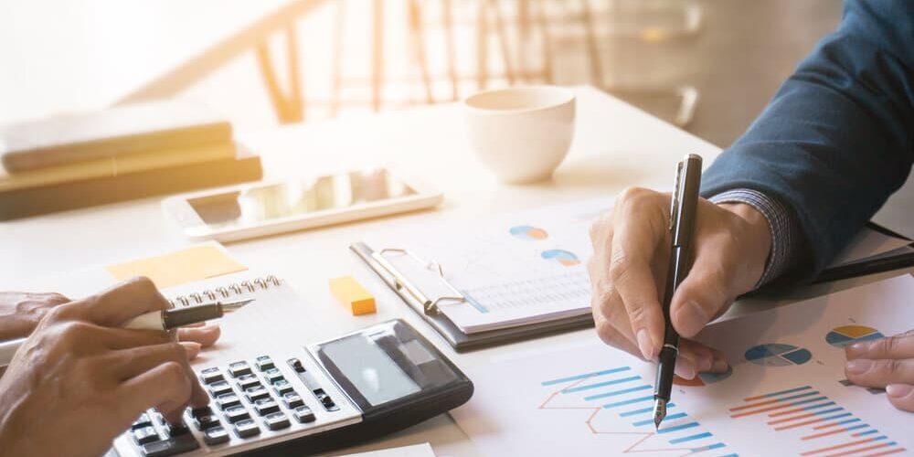 Business man analysis on data paper