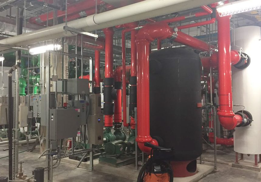 Plumbing system on red paint